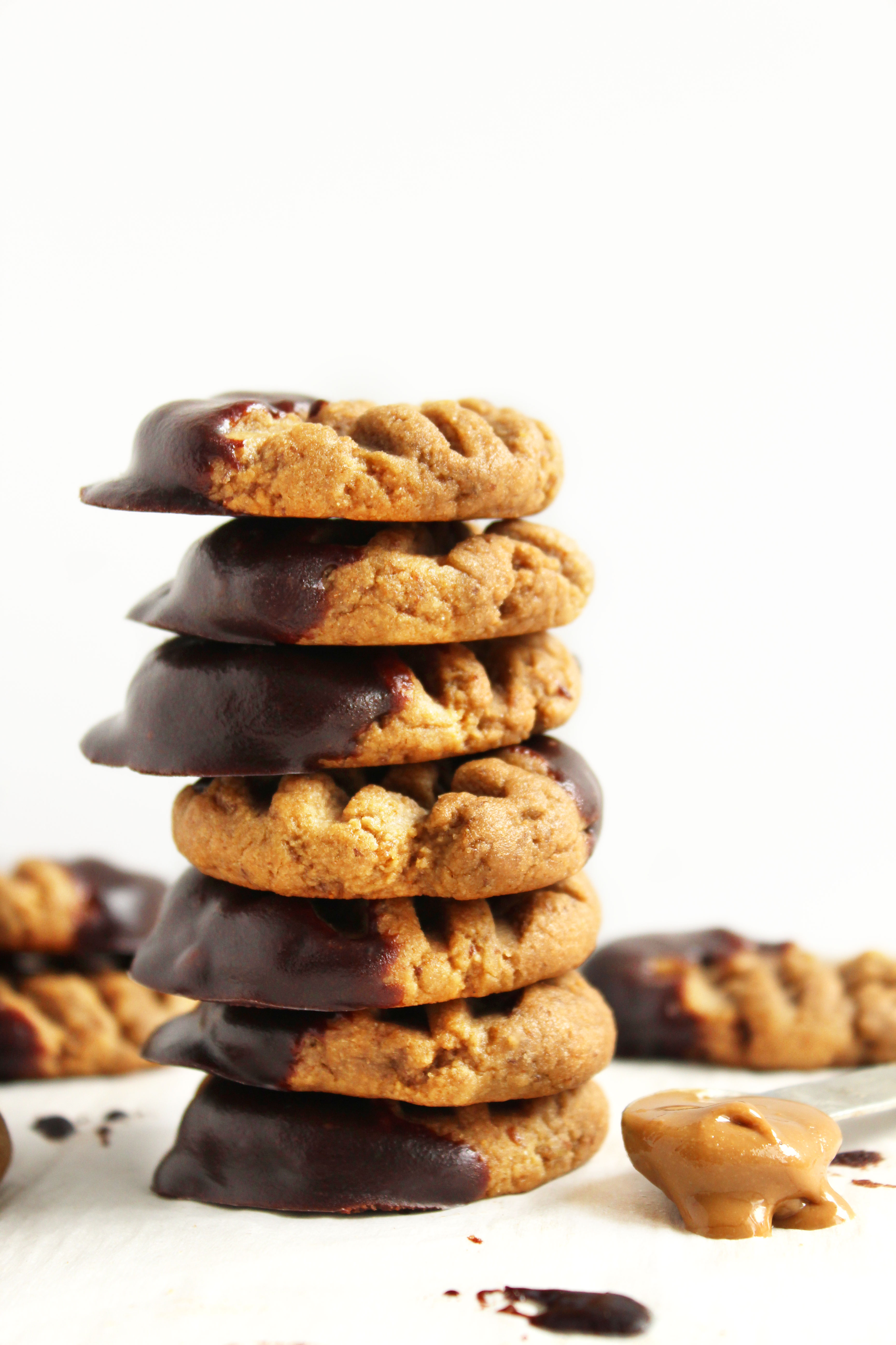 Chewy Chocolate Dipped Sunbutter Cookies (V + GF)! SUPER chewy, peanut-buttery, and delicious! Will cure any peanut butter/chocolate craving! #vegan #glutenfree #cookies   Peachandthecobbler.com